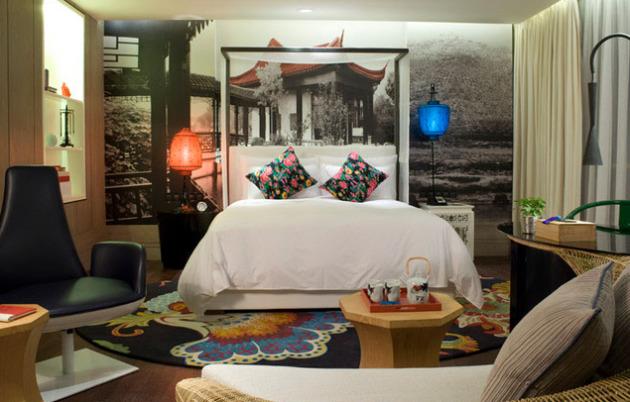 Фото: фотообои в интерьере спальни стиля фьюжн