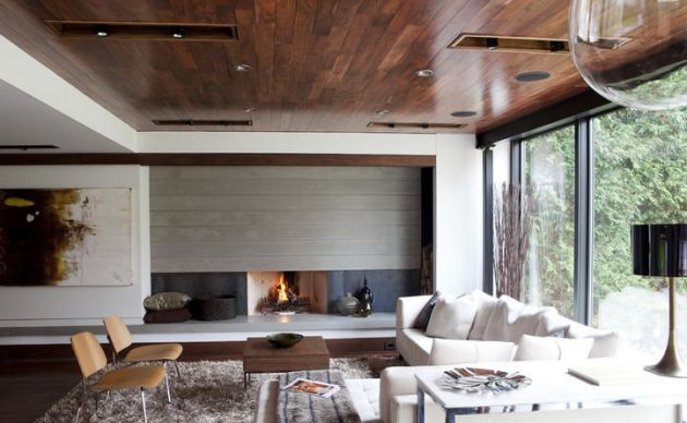 Фото: темный потолок поможет вам визуально уменьшить высоту комнаты