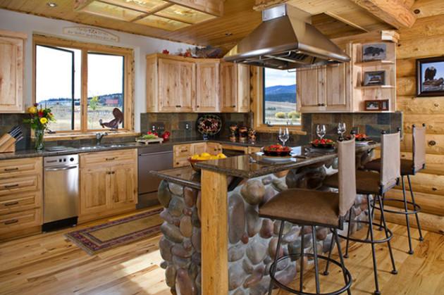 Фото: барная стойка из декоративного камня в интерьере кухни загородного дома