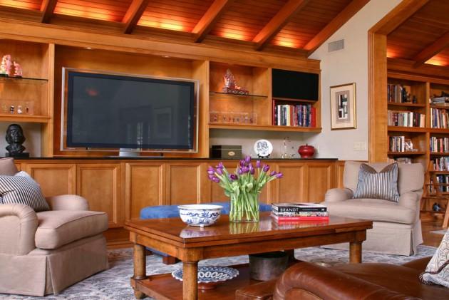 Фото: используя дерево с подсветкой в гостиной, можно подчеркнуть естественную красоту этого природного материала