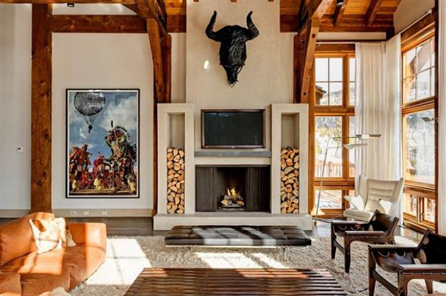 Фото:  прекрасным украшением интерьера послужат деревянные поленья, сложенные возле камина