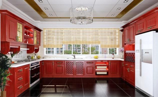 Дизайн просторной кухни с красными фасадами