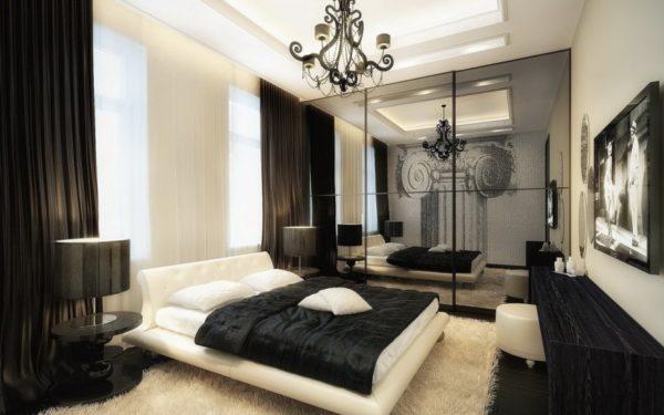 Спальня в серо-белых тонах с чёрным текстилем