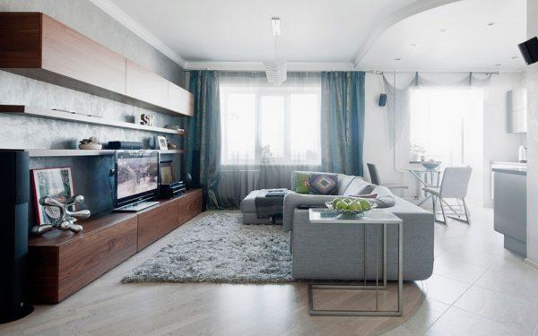 Гостиная в сео-голубых тонах с коричневой мебелью