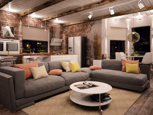 Гостиная с серой мебелью и разноцветными декоративными подушками