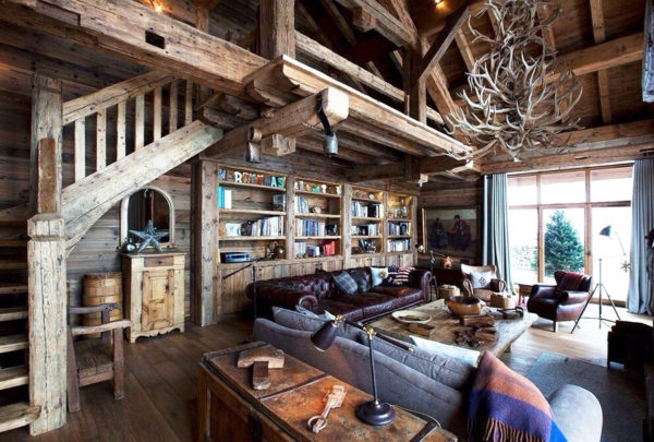 Гостиная с книжным шкафом и кожаной мебелью