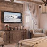 Бежевая спальня с большим комодом и телевизором