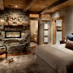 Спальня с электрокамином, вмонтированным в каменную кладку